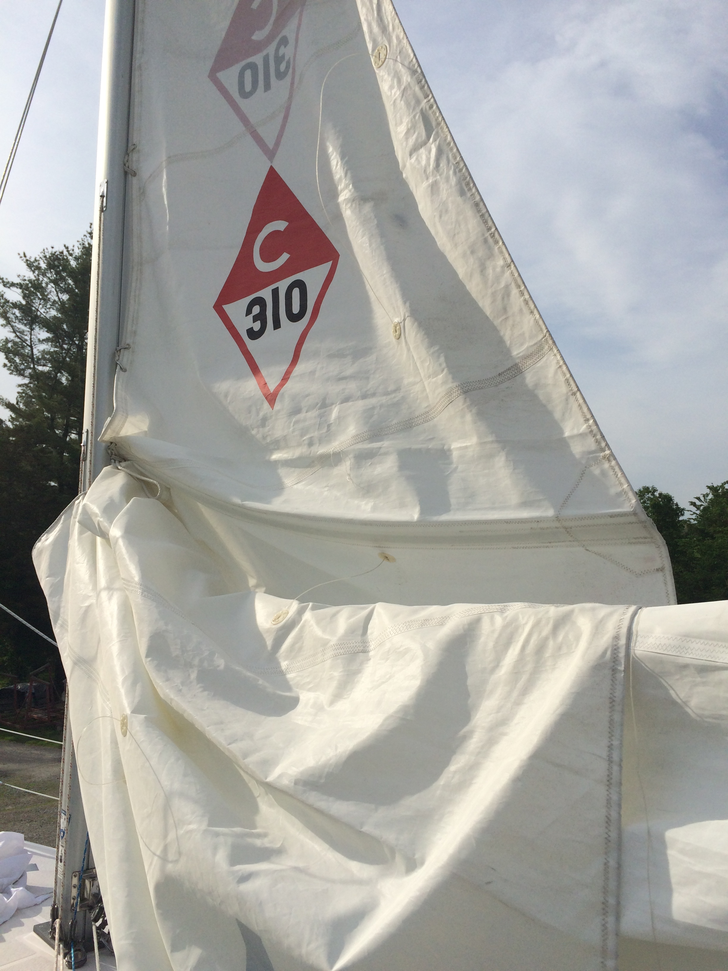 Installing newly repaired mainsail on May 29, 2015.