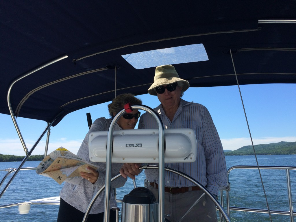 My father at the helm and my sister assisting with Errant's navigation. First sail of the season!