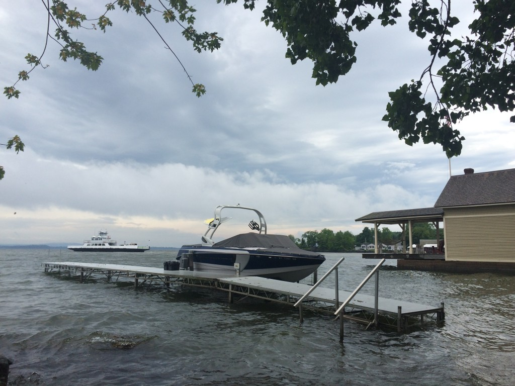 The rising Lake Champlain water level threatens our dock and runabout.